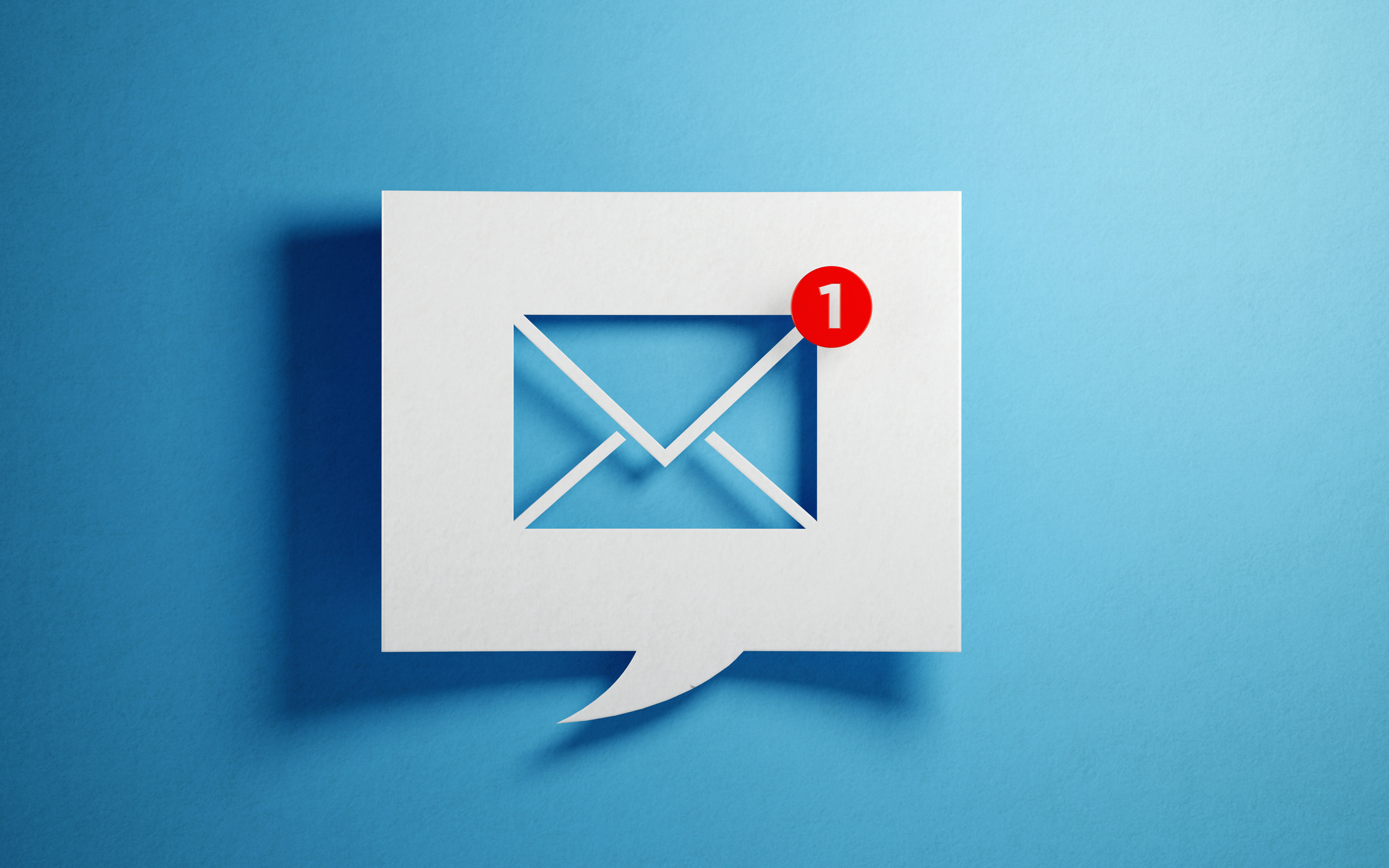 White-Chat-Bubble-With-Email-Symbol-On-Blue-Background